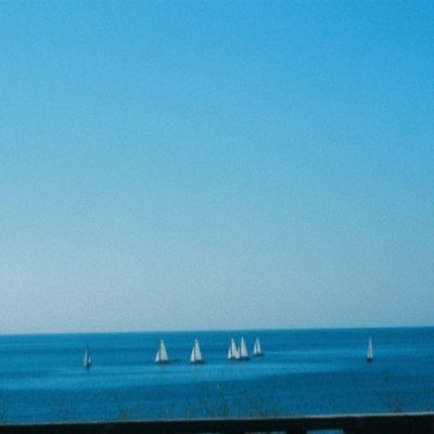 View of sailing boats from beach in Estoril Portugal