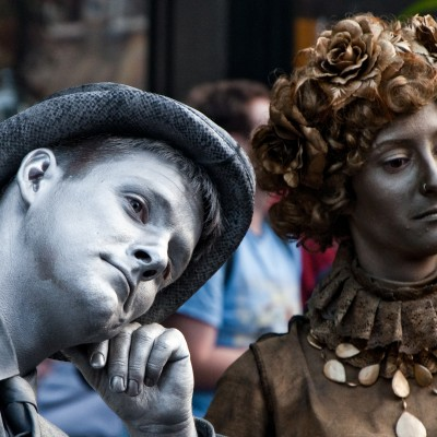 Edinburgh, Scotland - August 14th 2012. Two young actors dressed in silver and gold at Fringe Festival in Edinburgh.