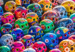Mexican Culture Fiesta: Colorful (colourful) traditional Mexican/hispanic ceramic pottery Day of the Dead (Dia de los Muertos) skulls on display at a market in Mexico.
