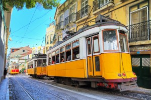 Beautiful image of the traditional yellow trams in Lisbon, Portugal. HDR