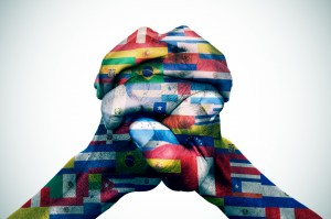 closeup of the hands of a young man put together patterned with the flags of the Latin American countries