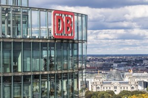Berlin: DB Logo on the top of Bahn Tower. It's a 26-story, 103m skyscraper on Potsdamer Platz in Berlin, Germany. Office space for the German Railway (Deutsche Bahn) HQ
