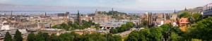 EDINBURGH, UK - AUG 9, 2012: Panoramic aerial view of the Old and New Town of Edinburg during the Olympics and the Fringe Festival