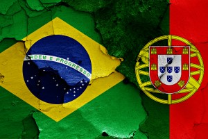 flags of Brazil and Portugal painted on cracked wall