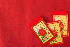 Red lucky money envelopes on red background