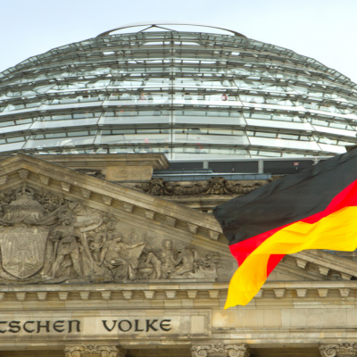 Image of the Reichstag Building in Berlin, Germany, with the German flag
