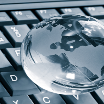 Picture of a silver globe sat on a grey keyboard