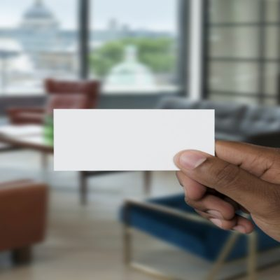 Picture of someone holding, what look like to be a blank business card