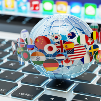 A picture of a globe surrounded by flags hovering over a keyboard
